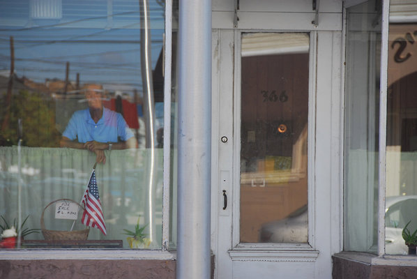 Bayonne Man in Window